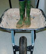 Mr. George's wheelbarrow and concrete boots